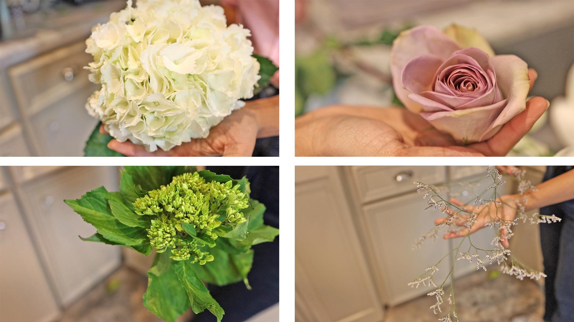 Amitha holding white and green hydrangea flowers, dusty pink rose, and sea lavender