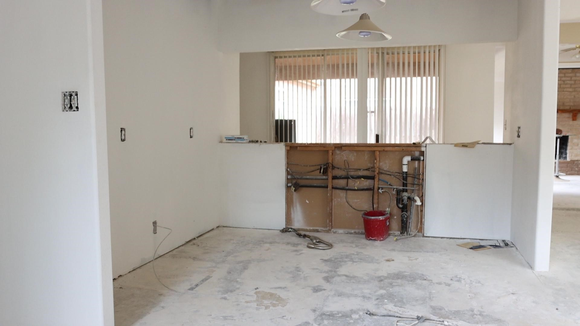 Unfinished 70s-built kitchen undergoes renovation to now include an open concept floor plan.