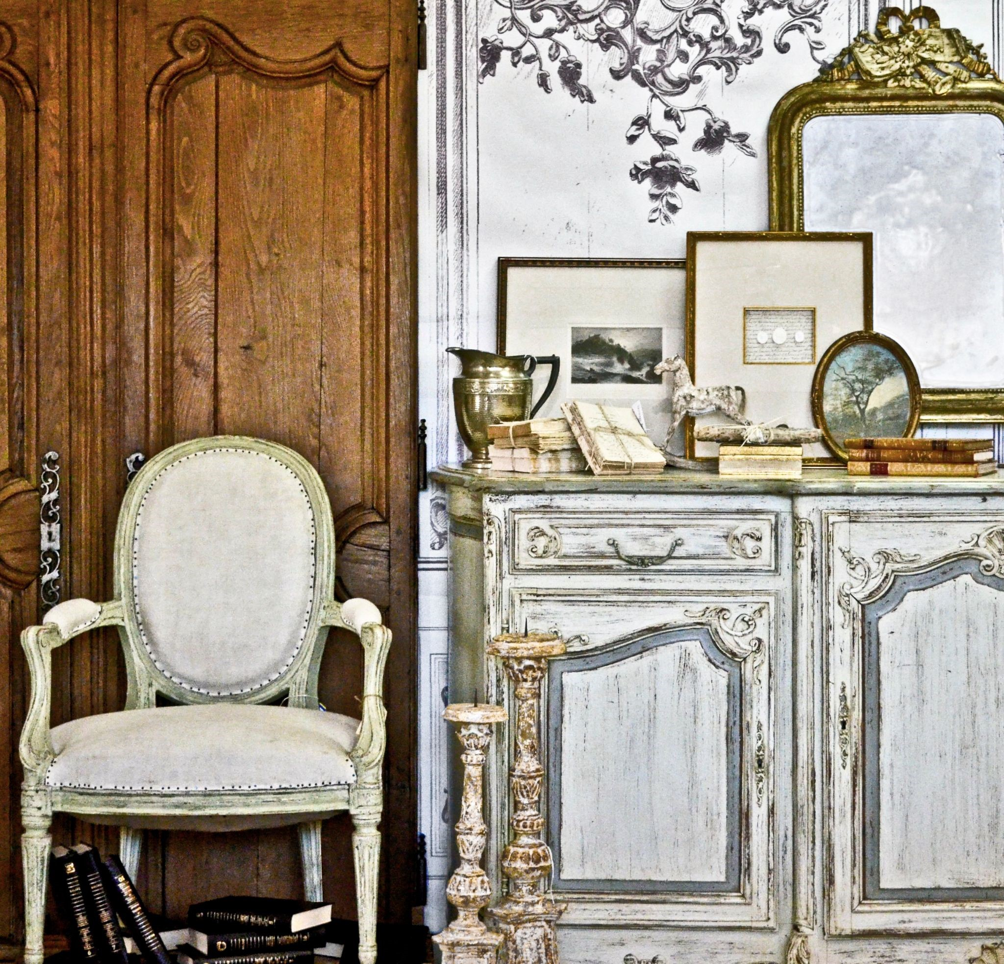Early Village Antiques, an Antique Store in Houston, showroom display with white-washed French country inspired furniture and farmhouse decor.