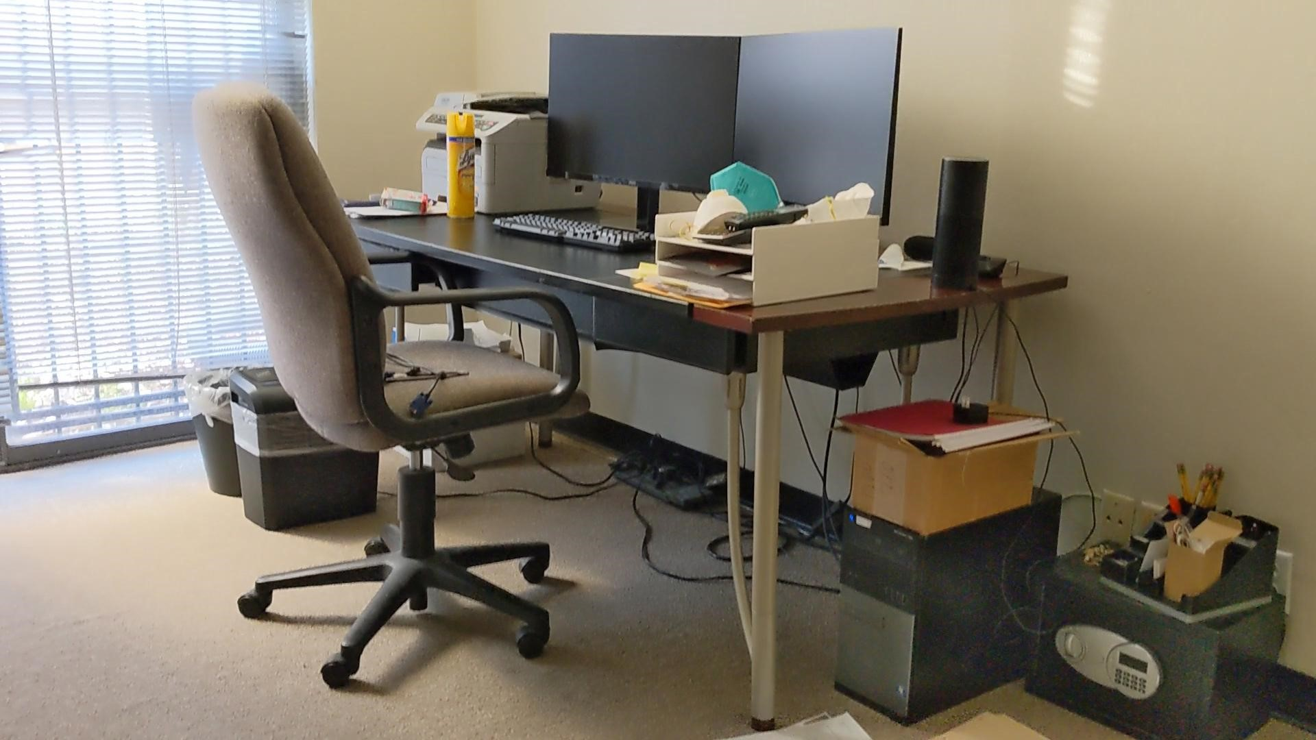 Amitha's work desk looks generic and does not match her farmhouse aesthetic.