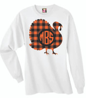 We love our Buffalo Plaid!  This is a digitally imprinted and is printed on a white, silver, or heather gray shirt unisex short sleeve shirt. These shirts are not fitted and run true to size.  It is also available in long sleeve, just give us a buzz at the store at 615-305-6432