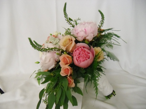 Cascading Bridal Bouquet with peonies, cabbage roses, spray roses, viburnum in soft peach and pink colors