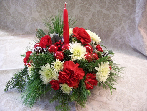 Traditional red and white centerpiece with a candle.