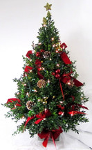 Boxwood table top tree with or without lights decorated with red bow, pine cones, and do-dads. Topped with a gold star.