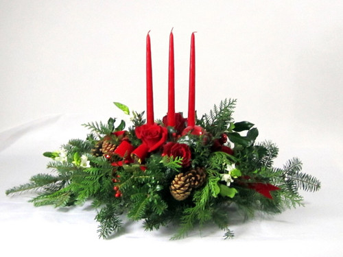 Christmas night. Long and low centerpiece with red roses and red candles.