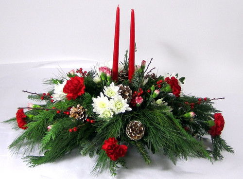 Elegant Centerpiece  with 2 red candles, natural pine cones, red and white flowers. Will fill a large table with abundance of fragrance.
