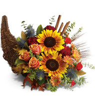 Bountiful Beauty of flowers designed for the perfect table by Chappell's Florist. Full of Fall foliage and flowers.