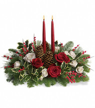 Beautiful centerpiece with 2 candles, white lilies, red roses, natural pine cones, and a touch of variegated holly. Hand delivered by Chappell's Florist in our local area.