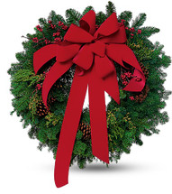 Wreath with a Red Velvet Bow and Pine cones. Designed by Chappell's Florist. Located in South Burlington Vermont.