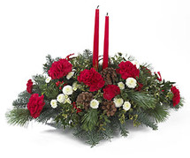 Long and Low centerpiece with scented winter greens, red carnations, pine cones and candles.  This will light up any table.