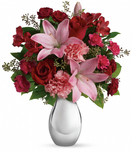 This romantic bouquet includes red roses, red spray roses, pink asiatic lilies, red alstroemeria, pink carnations and pink miniature carnations accented with assorted greenery.