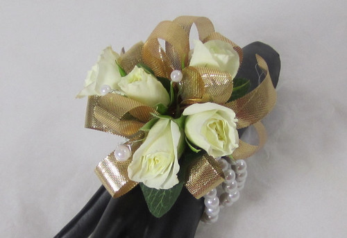Graceful Gold Corsage. Designed on a white beaded bracelet. This Gold and white wrist corsage will dazzle her. An exclusive design by Chappell's Florist