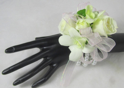 Beloved Blooms corsage for the wrist. Designed with orchids and roses. We can customize the ribbon to match your dress. A Chappell's exclusive