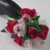 Big night beauty. Steal the show with this hot pink wrist corsage and green ivy. A Chappell's exclusive
