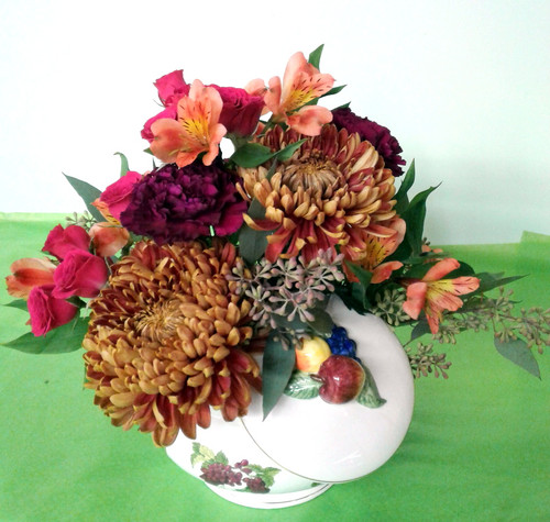 Beautiful Ceramic Fruit Compote with Lid. Flowers including football mums, carnations, alstromaria, and spray roses
