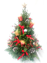 Table top Boxwood Tree with Presents, pinecones, red velvet bows, and berries. Wonderful gift for anyone.