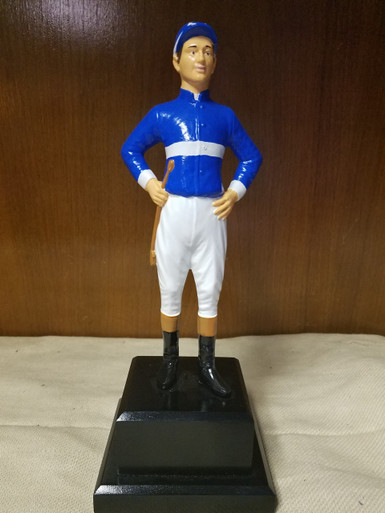 """9"""" Jockey mounted on wood base painted black.  May also be customized to be used as a lamp, book end or door stop."""