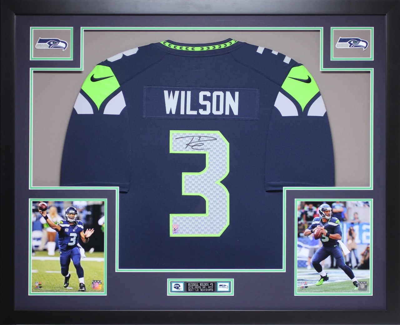 brand new ce3e6 9a79f Russell Wilson Autographed and Framed Navy Seahawks Jersey