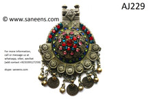 kuchi pendant with red stone