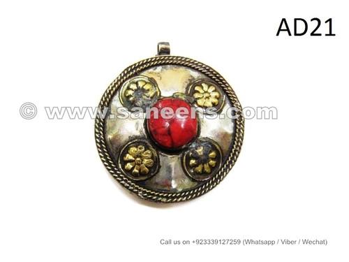 kuchi jewellery pendants with coral stones