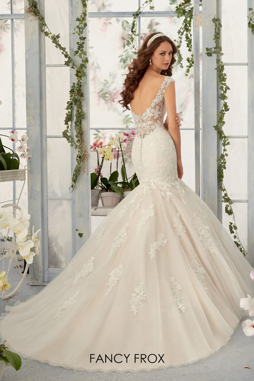 Mori Lee 5407 Alencon lace appliques with frosted beading on a tulle mermaid gown.