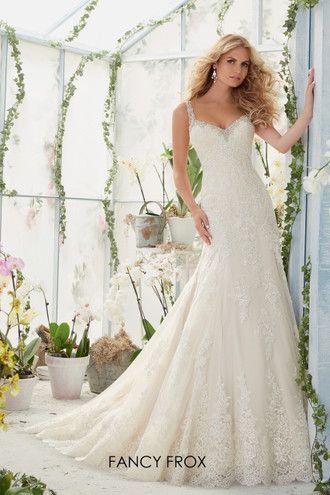 Mori Lee 2822. Embroidered edging with crystal beading meets the Alencon Lace appliques and scalloped hemline on the net gown.