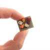 cheese board pin by inedible jewelry