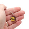 chocolate frosted yellow cake slice necklace by inedible jewelry