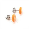 orange studs by inedible jewelry