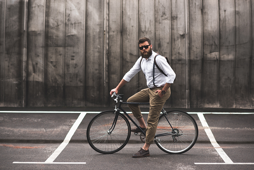 Bearded Man On Bike In Braces