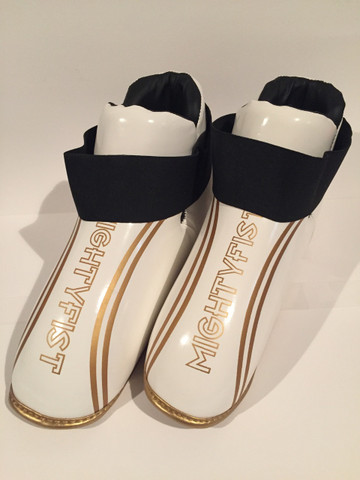 White and gold boots