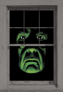 Green Demon Poster shown in a window
