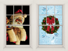 Santa Clause and Christmas Wreath WOWindow Posters Christmas Decorations as seen two window frames