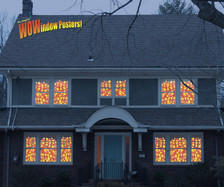 House showing 12 windows full of candy corn posters