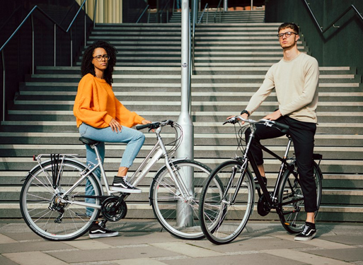 Commuters showing off Raleigh hybrid bikes in Dublin city