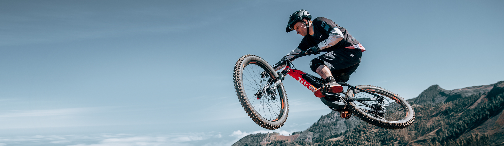Mountain biker whipping during jump