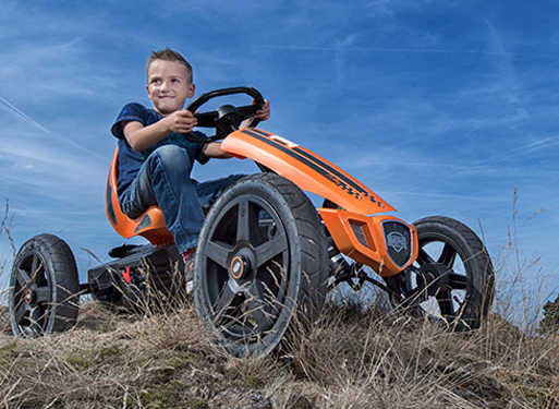 Boy on a Berg Go Kart in a field