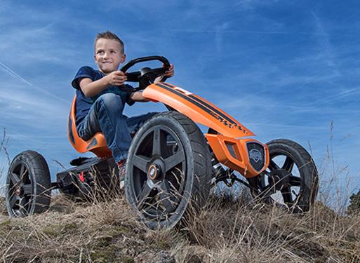 Boy on a Berg Go Kart in a field