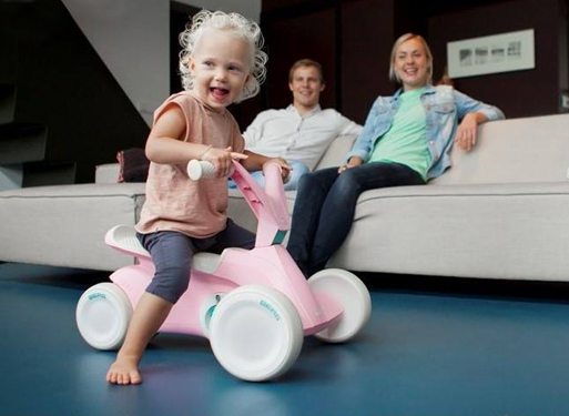 Little girl having fun on aBerg Go2 Kart in her living room