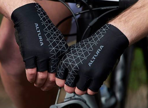 Man wearing fingerless Altura cycling gloves