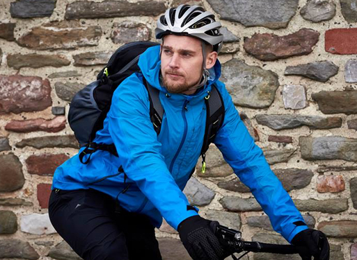 Cyclist prepared for the elements with his blue nevis jacket