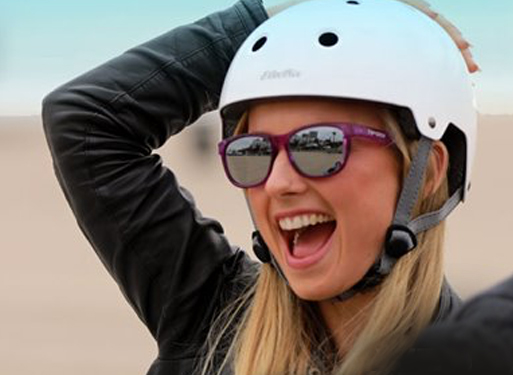 Girl wearing sunglasses and cycling helmet