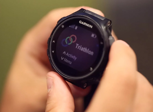 Person checking the times on a Garmin activity tracking watch