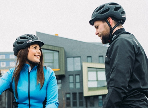 Pair of cyclists gearing up for a safe journey in Uvex helmets