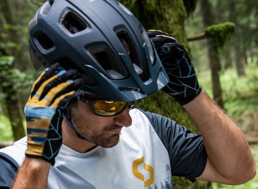 Cyclist wearing cutting edge Scott helmet