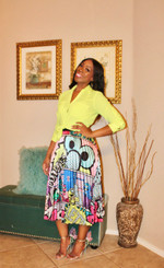 Pleated Midi Skirt Printed in Multicolored Sesame St Characters with a Banded Stretch Waist. One Size Fits All upto 2XL.