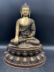 Bronze Buddha Sitting on a Louts