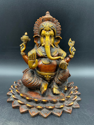 Ganesh Sitting on wide louts Flower