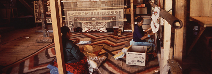 Navajo Women Weaving Rugs