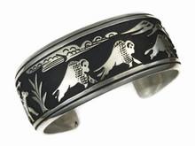 Sterling Silver Large Buffalo Hunt Bracelet by Tommy Singer, Navajo